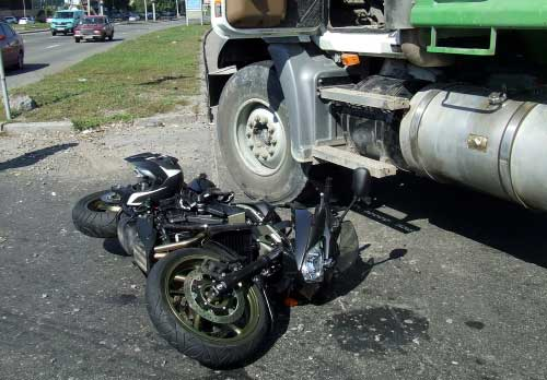 A motorcycle that has ran into a truck in Atlanta, GA.