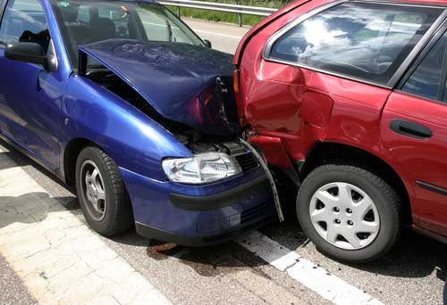 A rear-end collision between two cars on a busy road in Albany, GA.