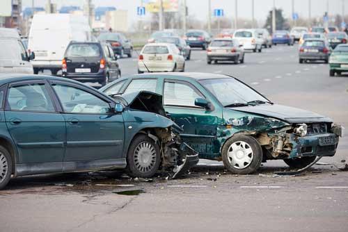 A car collision on a busy street.