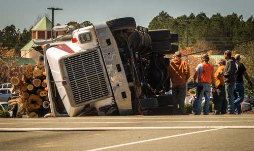 A truck that has rolled over on it's side.