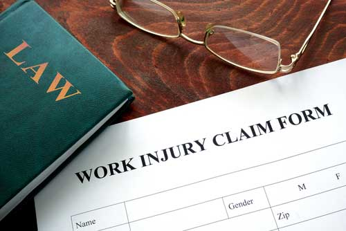 A work injury claim document lying on a table.