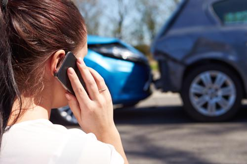 A Woman calling a Roswell car accident lawyer after being rear-ended.