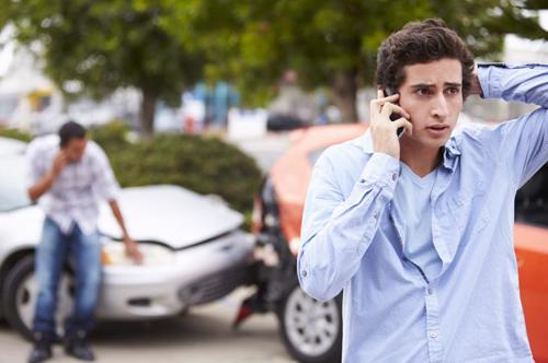 A man calling a Johns creek car accident lawyer after being rear-ended.