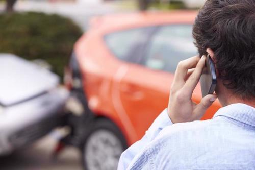 A man calling a Warner Robins car accident lawyer after being rear-ended.