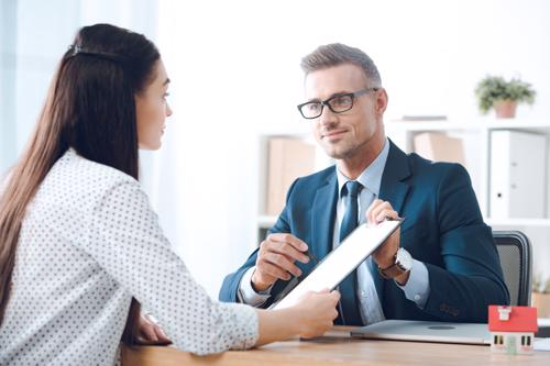 A woman meeting with a Stonecrest car accident lawyer to discuss the possibility of filing a claim.