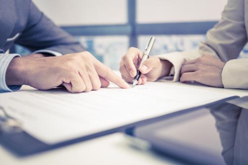 An Alpharetta car accident lawyer reviewing a settlement offer with a client.